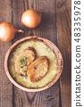 Bowl of onion soup 48335978