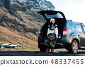 Female traveler enjoying Iceland view from the car 48337455