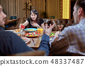 Woman Feeling Sick While Eating Bad Food in a Restaurant. Dinner customer having a bad experience 48337487