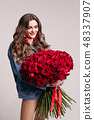 Gorgeous woman with big earings holding roses and 48337907