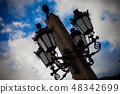 Retro vintage street lamp lantern in a city 48342699
