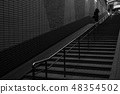 A women leaving up a staircase 48354502