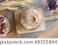 Sourdough bread in a basket on a table 48355844