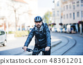 Hipster businessman commuter with bicycle traveling to work in city. 48361201