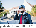 Businessman commuter going home from work in city, drinking coffee. 48361213
