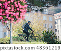 Hipster businessman commuter with bicycle traveling to work in city. 48361219