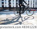 Midsection of male courier with bicycle delivering packages in city. Copy space. 48361228