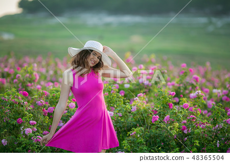Girl in pink dress and vintage Cap 48365504