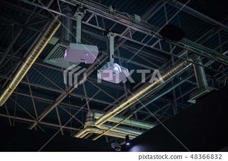 White projector is on the ceiling at the factory 48366832