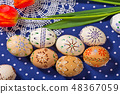 Easter eggs and tulip on the blue tablecloth 48367059