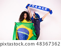 Two fans of the Brazil team and the France team 48367362