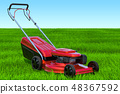Lawn mower in the green grass against blue sky 48367592