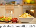 French fries and salad on table 48367824