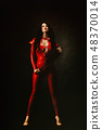 Sexy woman in red latex jumpsuit 48370014