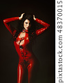 Sexy woman in red latex jumpsuit 48370015