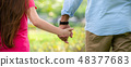 Father and daughter holding hands in the park. 48377683