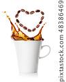 Splash in cup of black coffee from grains falling in shape of heart 48386469