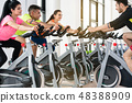 People cycling in a row 48388909