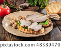 Sandwich with baked pork belly 48389470
