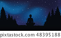sitting person in meditation pose looks in the starry sky 48395188