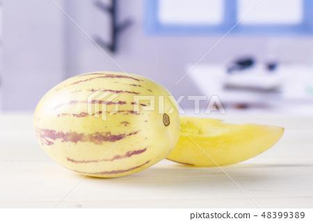 Fresh striped pepino melon with blue window 48399389