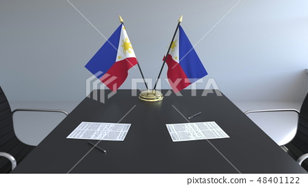 Flags of Philippines and papers on the table. Negotiations and signing an agreement. Conceptual 3D 48401122