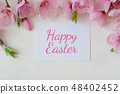 Easter background with a bouquet of spring flowers and the inscription happy Easter . Festive Easter 48402452
