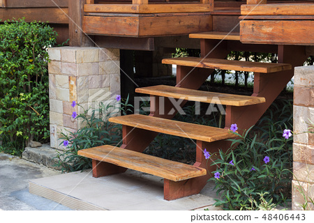 Exterior wooden stairs to house entrance 48406443