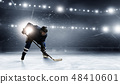 Ice hockey player at rink 48410601