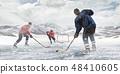 Playing hockey game 48410605