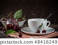 Tea and cherry jam on a wooden table 48416249