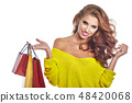Shopping woman holding bags, isolated on white studio background 48420068