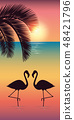 two flamingos and palm tree silhouette on colorful beach at sunset 48421796