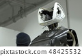 Modern Robotic Technologies. The engineer creates a modern robot or android. Production and 48425532