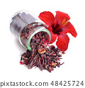 Dry hibiscus tea in glass jar with flower. 48425724
