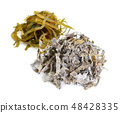 Heaps of raw and dried kelp isolated  48428335