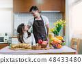sweet asian couple happiness preparing breakfast 48433480