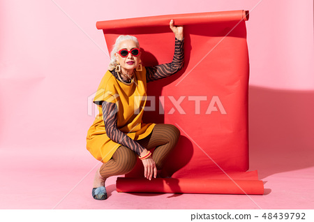 Attractive mature woman expressing positivity during shooting 48439792