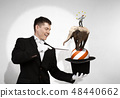 Man magician with cylinder hat 48440662