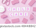 Children care text on pink toy object background 48448842