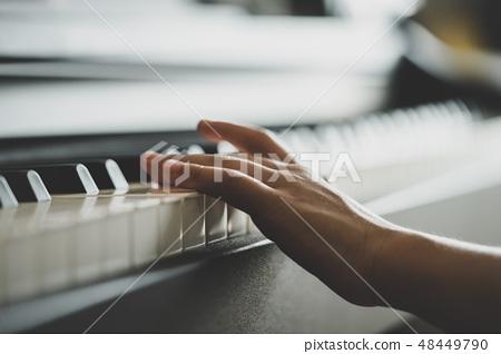 little Hand playing Music keyboard upright Piano 48449790