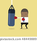 African businessman punching the punch bag. 48449889