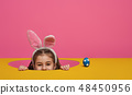 Girl with painted eggs 48450956