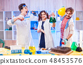 Cheerful lab assisntants with equipment 48453576