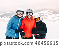 Happy family in winter clothing at the ski resort 48459915