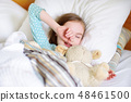 Adorable little girl sleeping in the bed with her toy 48461500