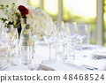 Beautiful table setting with crockery and flowers 48468524