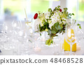 Beautiful table setting with crockery and flowers 48468528