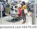 female, shop, customer 48476199