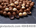 Macadamia nuts on black table, Selective focus. 48484608